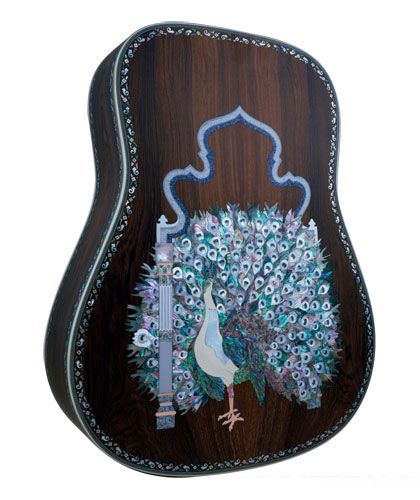 Laser engraved guitar body with laser cut mother of pearl inlay