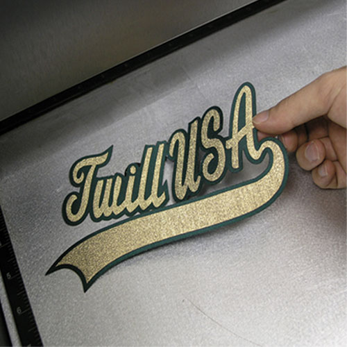 Laser cut, multi-layer twill appliqué