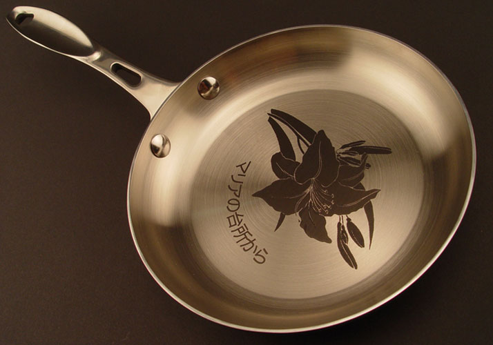 Laser marked stainless steel frying pan (using marking compound)