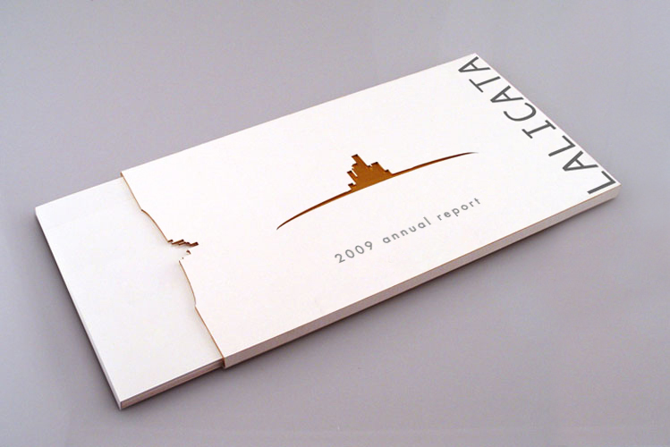 Laser cut and engraved cardstock annual report