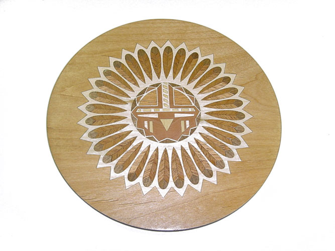 Laser engraved wood coaster with laser cut wood inlay