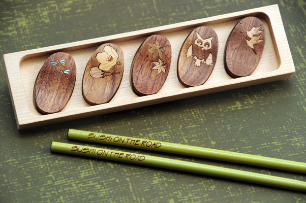 Laser engraved chopsticks and sushi set with laser cut mother of pearl