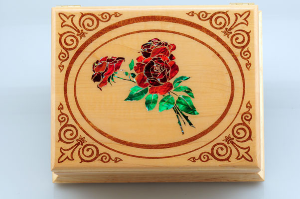 Laser engraved wood box with laser cut mother-of-pearl inlay
