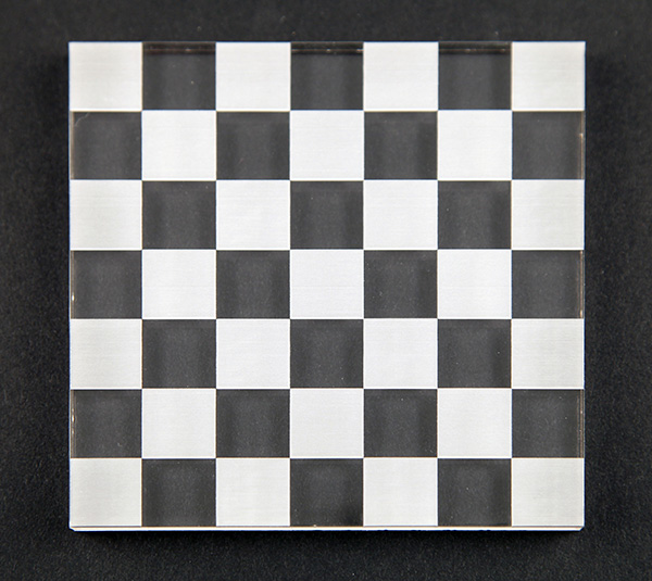 A checkerboard pattern marked onto a clear acrylic sheet