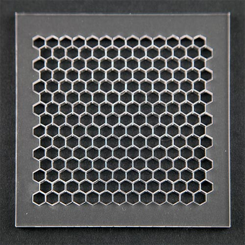 A honeycomb pattern cut out of an acrlyic sheet